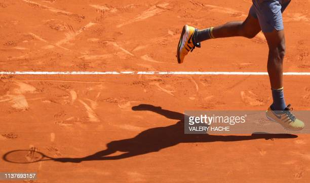 Canada's Felix AugerAliassime plays a backhand return to Germany's Alexander Zverev during their tennis match on the day 5 of the MonteCarlo ATP...