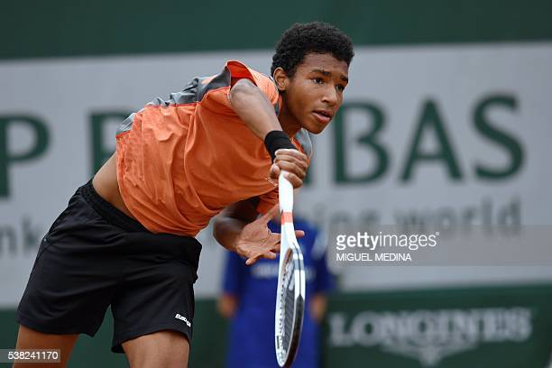 Canada's Felix AugerAliassime returns the ball to France's Geoffrey Blancaneaux during their boy's singles final match at the Roland Garros 2016...