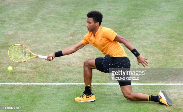 Canada's Felix AugerAliassime returns the ball to Germany's Dustin Brown in their quarterfinal match at the ATP Mercedes Cup tennis tournament in...