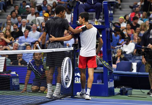 Canada's Felix Auger-Aliassime speaks with Spain's Carlos Alcaraz after Alcaraz retired from the match conceding the win to Auger-Aliassime at the...