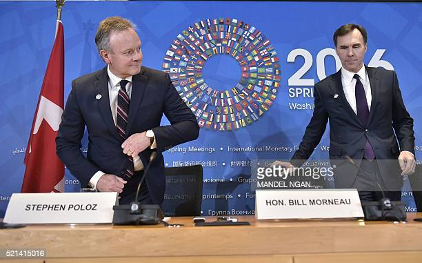 Canada's Finance Minister Bill Morneau and Bank of Canada Governor Stephen Poloz arrive for a press conference during the annual International...