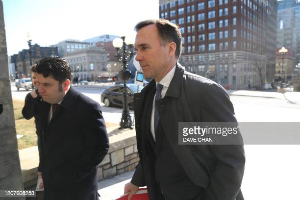 Canada's Finance Minister Bill Morneau arrives for a news conference on Parliament Hill March 18 2020 in OttawaOntario Canadian Prime Minister Justin...