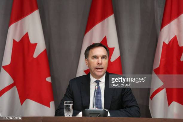 Canada's Finance Minister Bill Morneau speaks during a news conference on Parliament Hill March 18 2020 in Ottawa Ontario Canadian Prime Minister...