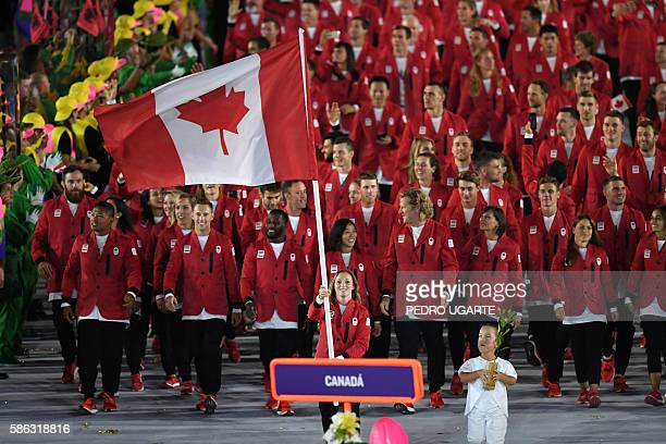 Canada's flagbearer Rosannagh Maclennan leads her delegation during the opening ceremony of the Rio 2016 Olympic Games at the Maracana stadium in Rio...