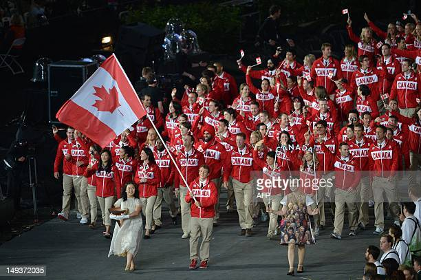 Canada's flagbearer Simon Whitfield leads his country's delegation during the opening ceremony of the London 2012 Olympic Games on July 27 2012 at...
