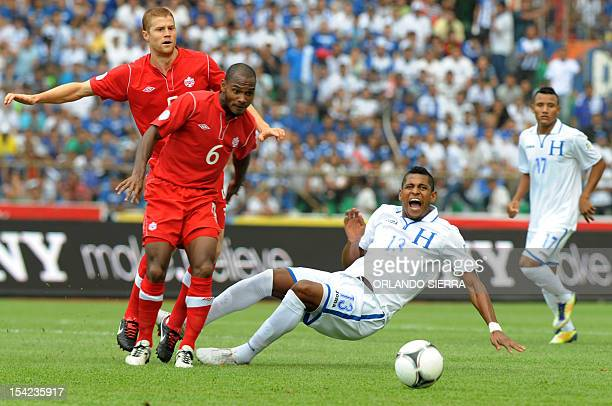 Canada's footballer Julian De Guzman and Hondura's Carlo Costly vie for the ball, during the Brazil 2014 FIFA World Cup North, Central America and...
