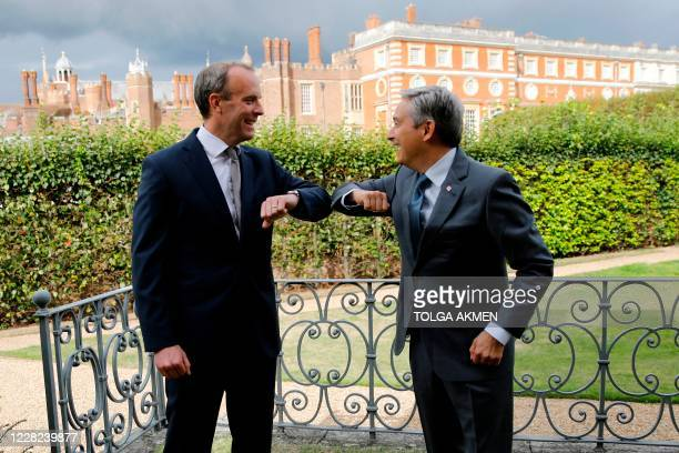 Canada's foreign minister Francois-Philippe Champagne and Britain's Foreign Secretary Dominic Raab pose for a photograph in the gardens of Hampton...