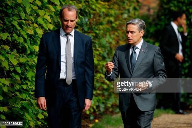 Canada's foreign minister Francois-Philippe Champagne talks with Britain's Foreign Secretary Dominic Raab in the gardens at Hampton Court Palace, in...