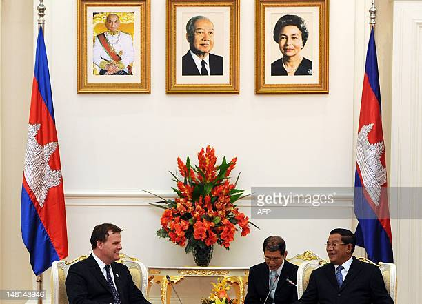 Canada's Foreign Minister John Baird talks to Cambodian Prime Minister Hun Sen during the 45th Association of Southeast Asian Nations Foreign...