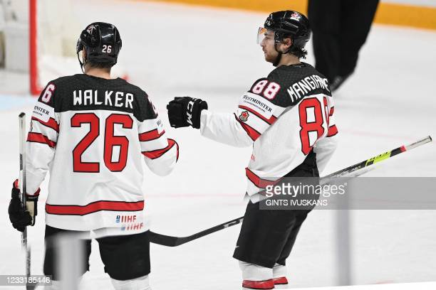 Canada's forward Andrew Mangiapane celebrates with Canada's defender Sean Walker scoring the 1-5 during the IIHF Men's Ice Hockey World Championships...