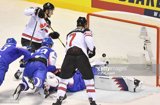 Canada's forward Anthony Cirelli scores during the IIHF Men's Ice Hockey World Championships Group A match between Slovakia and Canada on May 13,...