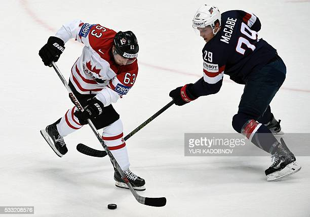 Canada's forward Brad Marchand vies with US defender Jake McCabe during the semifinal game Canada vs USA at the 2016 IIHF Ice Hockey World...