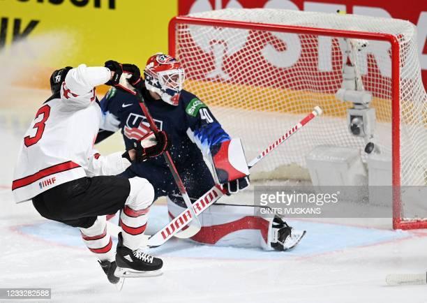 Canada's forward Brandon Pirri scores the 1-0 goal against US' goalkeeper Calvin Petersen during the IIHF Men's Ice Hockey World Championships...