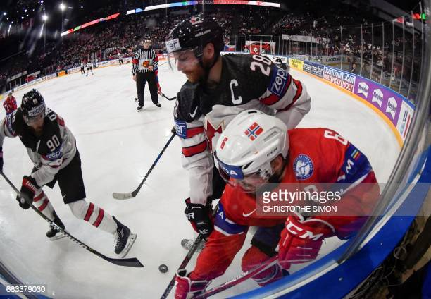 Canada's forward Claude Giroux vies with Norway's defender Jonas Holos during the IIHF Men's World Championship group B ice hockey match between...