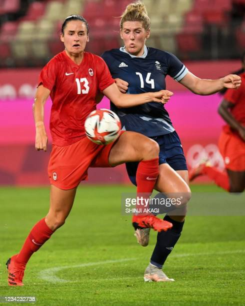 Canada's forward Evelyne Viens fights for the ball Britain's defender Millie Bright during the Tokyo 2020 Olympic Games women's group E first round...
