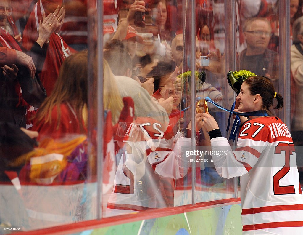 Canada's forward Gina Kingsbury (27) looks at the fans during the medals ceremony in the Woman's Ice Hockey games at the Canada Hockey Place during the XXI Winter Olympic Games in Vancouver, Canada on February 25, 2010. Canada beat the USA 2-0 to win the gold and Finland beat Sweden 3-2 to win the bronze.