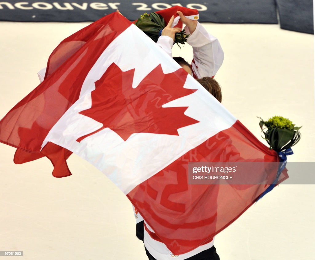 Canada's forward Hayley Wickenheiser (22) skates with the national flag during the medals ceremony in the Woman's Ice Hockey games at the Canada Hockey Place during the XXI Winter Olympic Games in Vancouver, Canada on February 25, 2010. Canada beat the USA 2-0 to win the gold and Finland beat Sweden 3-2 to win the bronze.