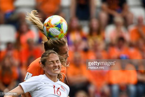 TOPSHOT Canada's forward Janine Beckie and Netherlands' defender Desiree van Lunteren head the ball during the France 2019 Women's World Cup Group E...