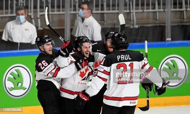 Canada's forward Justin Danforth celebrates with teammates Canada's defender Sean Walker, Canada's forward Connor Brown and Canada's forward Nick...