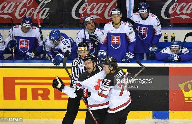 Canada's forward Mark Stone and Canada's defender Thomas Chabot celebrate Canada's winning goal during the IIHF Men's Ice Hockey World Championships...