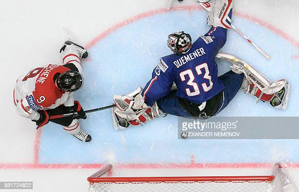 TOPSHOT Canada's forward Matt Duchene scores a goal past France's goalie Ronan Quemener during the group B preliminary round game Canada versus...