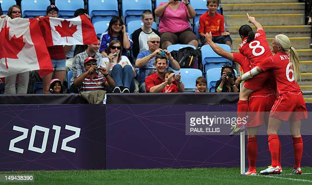 Canada's forward Melissa Tancredi celebrates scoring during the London 2012 Olympic women's football match between Canada and South Africa on July 28...