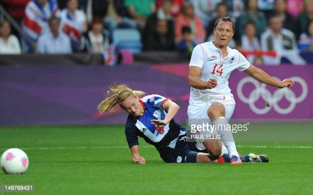 Canada's forward Melissa Tancredi shoots past Britain's defender Sophie Bradley during the 2012 London Olympic Games women's football quarter final...