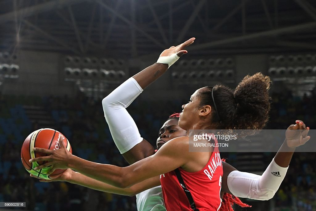 TOPSHOT - Canada's forward Nayo Raincock-Ekunwe goes to the basket past France's centre Isabelle Yacoubou during a Women's quarterfinal basketball match between France and Canada at the Carioca Arena 1 in Rio de Janeiro on August 16, 2016 during the Rio 2016 Olympic Games. / AFP / Mark RALSTON