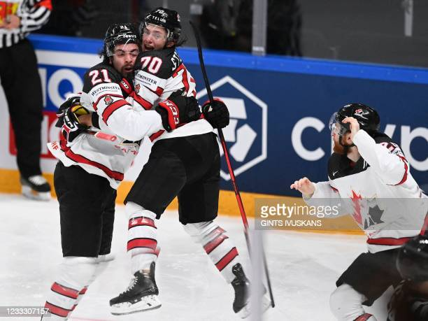 Canada's forward Nick Paul celebrates scoring the winning 3-2 goal with team mate Canada's defender Troy Stecher during the IIHF Men's Ice Hockey...