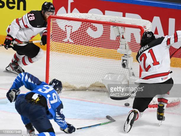 Canada's forward Nick Paul scores the winning 3-2 goal during the IIHF Men's Ice Hockey World Championships final match between the Finland and...