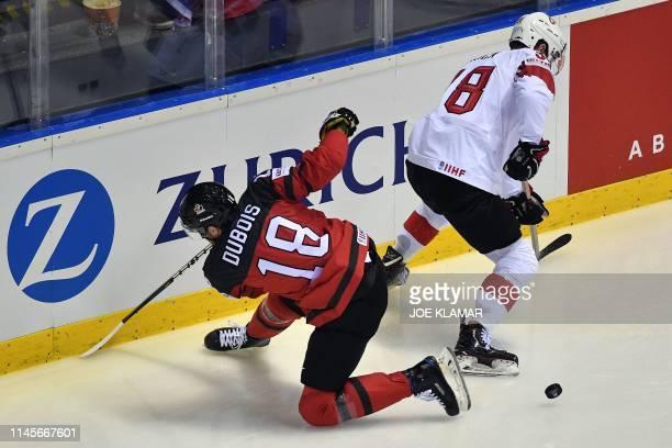 Canada's forward Pierre-Luc Dubois and Switzerland's defender Lukas Frick vie during the IIHF Men's Ice Hockey World Championships quarter-final...