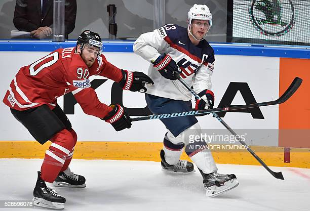 Canada's forward Ryan O'Reilly vies with US forward Matt Hendricks during the group B preliminary round game USA vs Canada at the 2016 IIHF Ice...