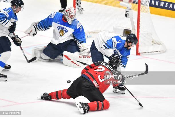 Canada's forward Sam Reinhart AND Finland's defender Mikko Lehtonen vie during the IIHF Men's Ice Hockey World Championships final between Canada and...