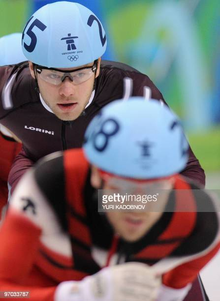 Canada's FrancoisLouis Tremblay and Latvia's Haralds Silovs compete in the Men's 500m Short Track Speedskating heats at the Pacific Coliseum in...