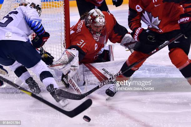 Canada's Genevieve Lacasse defends her goal in the women's preliminary round ice hockey match between the US and Canada during the Pyeongchang 2018...