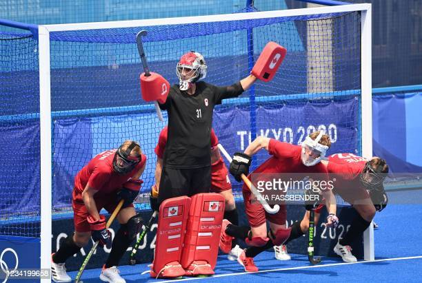 Canada's goalkeeper Antoni Pawel Kindler and teammates defend their goal during their a penalty corner in favour of Britain during their men's pool B...
