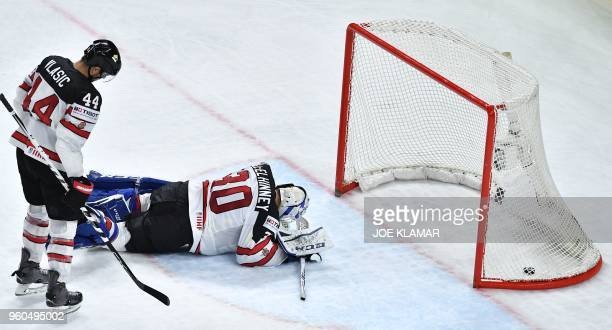 TOPSHOT Canada's goalkeeper Curtis McElhinney fails to save the puck during the bronze medal match USA vs Canada of the 2018 IIHF Ice Hockey World...