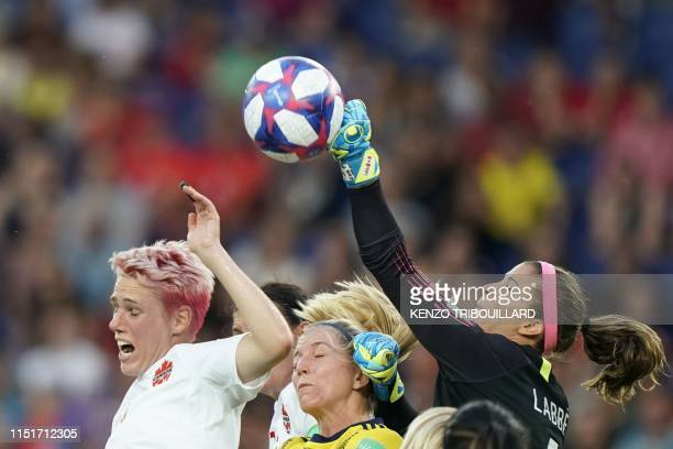 Canada's goalkeeper Stephanie Labbe boxes the ball during the France 2019 Women's World Cup round of sixteen football match between Sweden and...