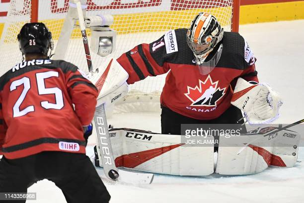 Canada's goaltender Carter Hart saves the puck during the IIHF Men's Ice Hockey World Championships Group A match between Britain and Canada on May...