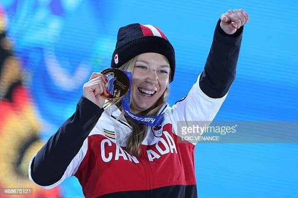 Canada's gold medalist Alex Bilodeau celebrates on the podium during the Men's Freestyle Skiing Moguls Medal Ceremony at the Sochi medals plaza...