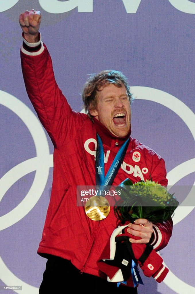 Canada's gold medalist Jon Montgomery celebrates on the podium during the medal ceremony of the men's skeleton final event of the Vancouver Winter Olympics in Whistler on February 20, 2010.
