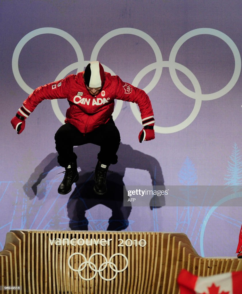 Canada's gold medalist Jon Montgomery jumps on the podium during the medal ceremony of the men's skeleton final event of the Vancouver Winter Olympics in Whistler on February 20, 2010.