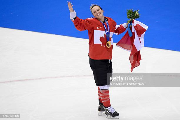Canada's gold medalist Marie-Philip Poulin celebrates during the Women's Ice Hockey Medal Ceremony at the Bolshoy Ice Dome plaza during the Sochi...