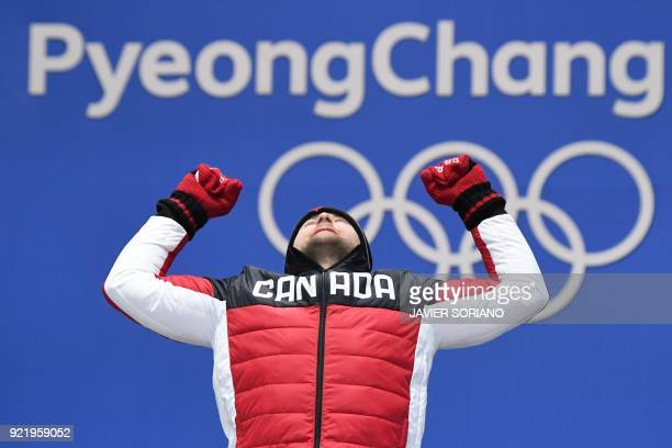 Canada's gold medallist Brady Leman poses on the podium during the medal ceremony for the freestyle skiing Men's Ski Cross at the Pyeongchang Medals...