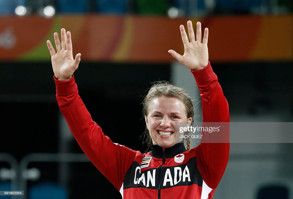 Canada's gold medallist Erica Elizabeth Wiebe celebrates on the podium at the end of the women's 75kg freestyle wrestling event at the Carioca Arena 2 in Rio de Janeiro on August 18, 2016, during the Rio 2016 Olympic Games. / AFP / Jack GUEZ