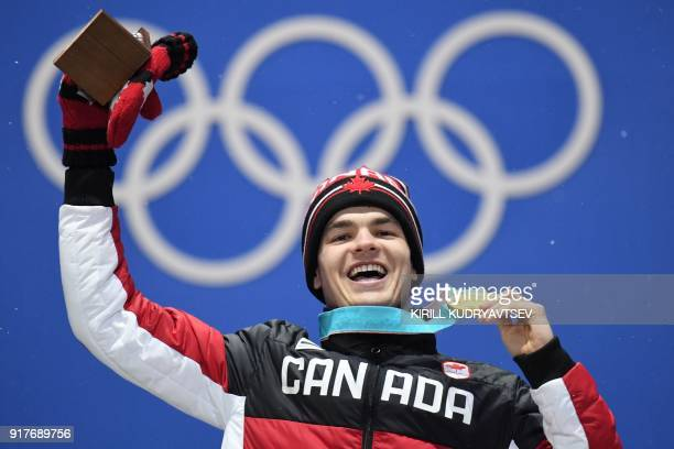 Canada's gold medallist Mikael Kingsbury poses on the podium during the medal ceremony for the freestyle skiing men's moguls at the Pyeongchang...