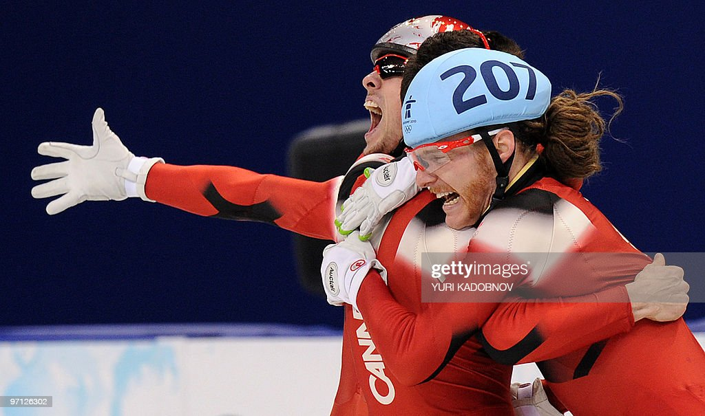 Canada's gold medallist Olivier Jean celebrates at the end of the Men's 5000 m relay short-track final at the Pacific Coliseum in Vancouver, during the 2010 Winter Olympics on February 26, 2010.