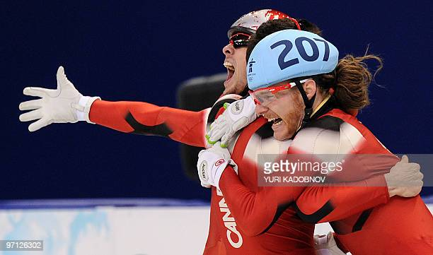 Canada's gold medallist Olivier Jean celebrates at the end of the Men's 5000 m relay shorttrack final at the Pacific Coliseum in Vancouver during the...