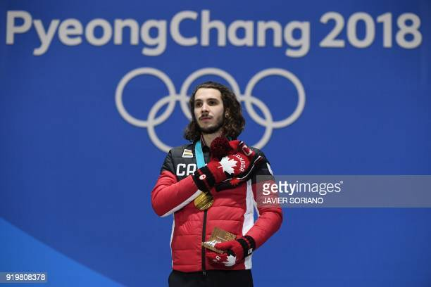 Canada's gold medallist Samuel Girard poses on the podium during the medal ceremony for the short track men's 1000m at the Pyeongchang Medals Plaza...