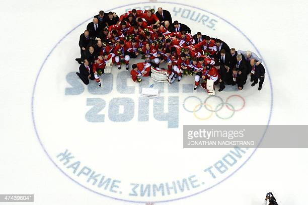 Canada's gold medallist team celebrates during the Men's Ice Hockey Medal Ceremony at the Bolshoy Ice Dome during the Sochi Winter Olympics on...